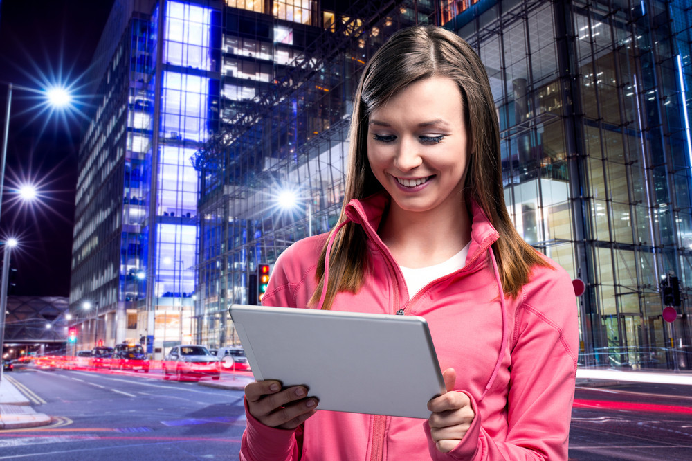 Young runner with smart phone in the city