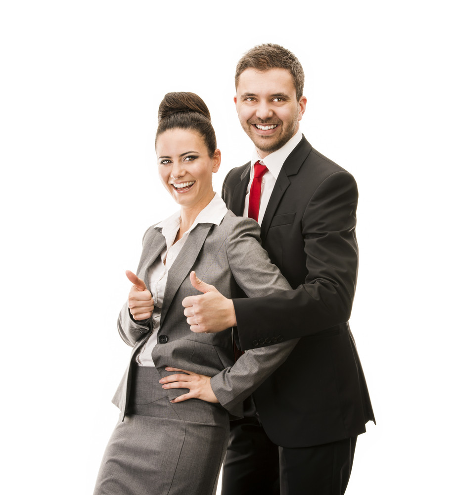 Young smiling business woman and business man isolated over white background. Crazy and funny posing in studio.