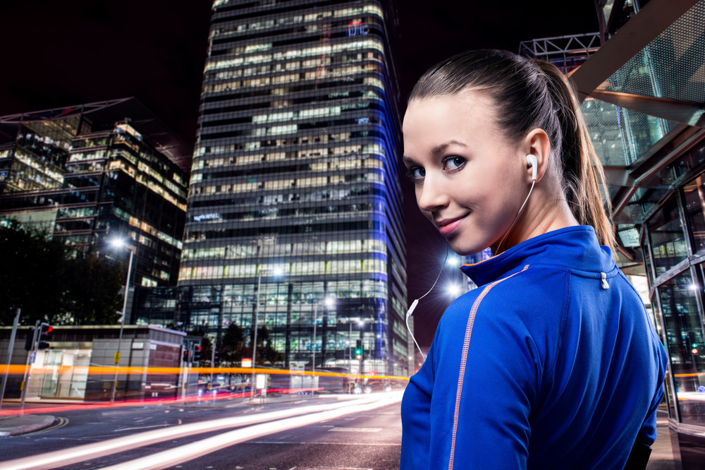 Young woman jogging outside in the city