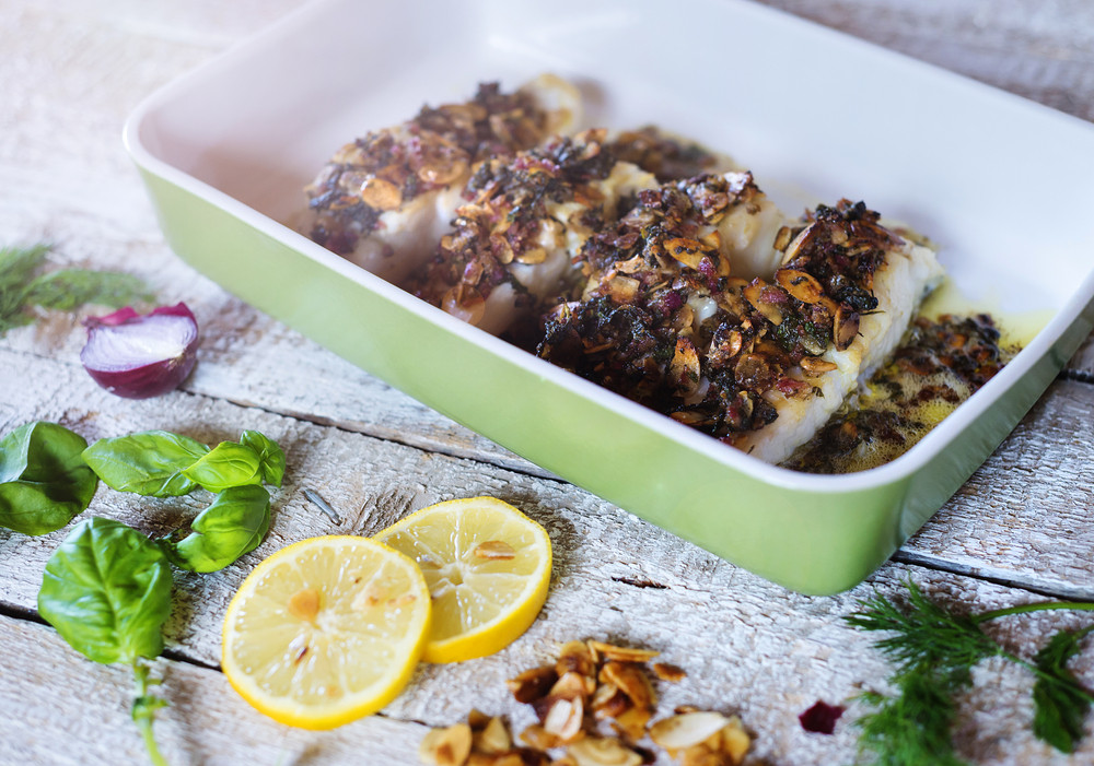 Zander fish fillets in green ceramic dishware