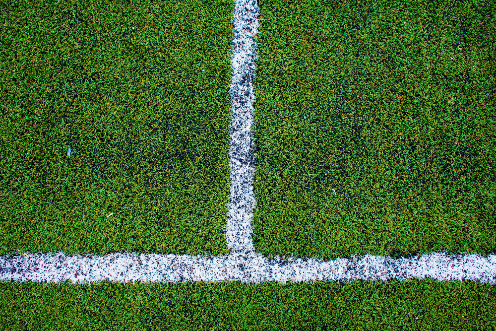 green natural grass of a Football soccer field