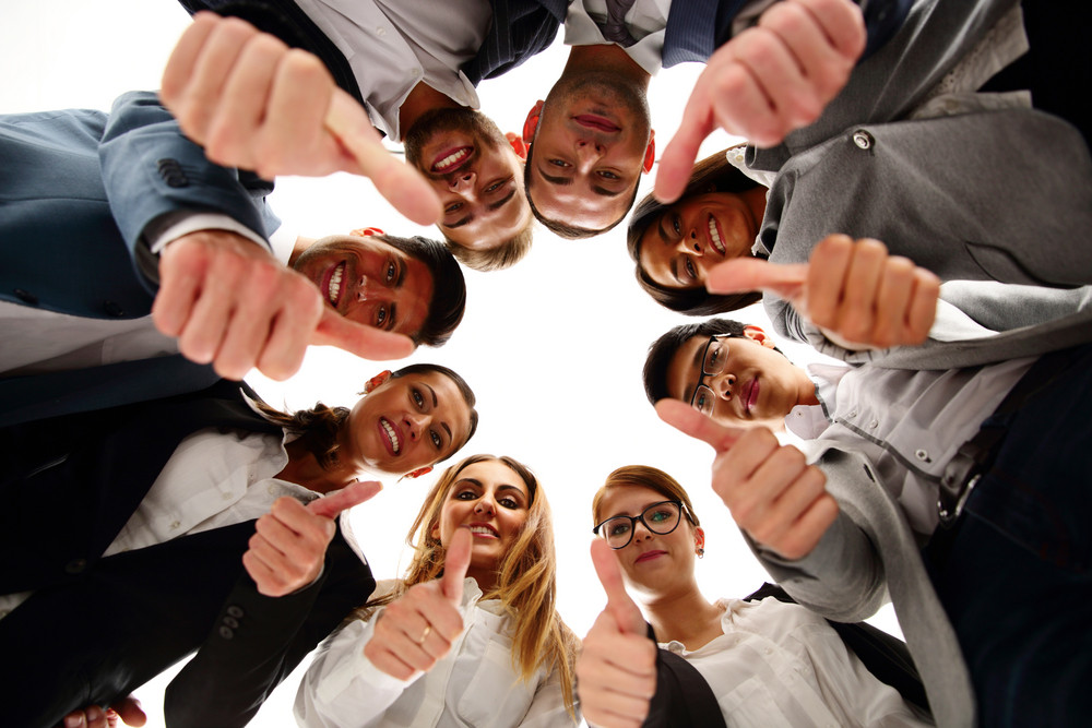 Group of business people standing in circle