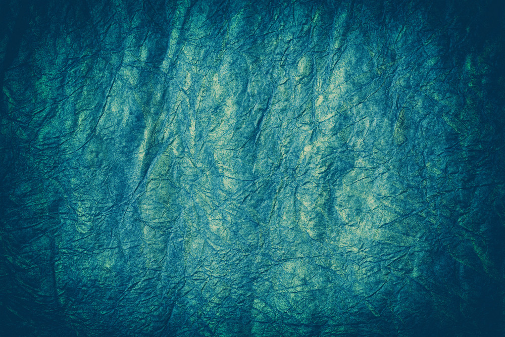 Grunge blue crumpled paper background