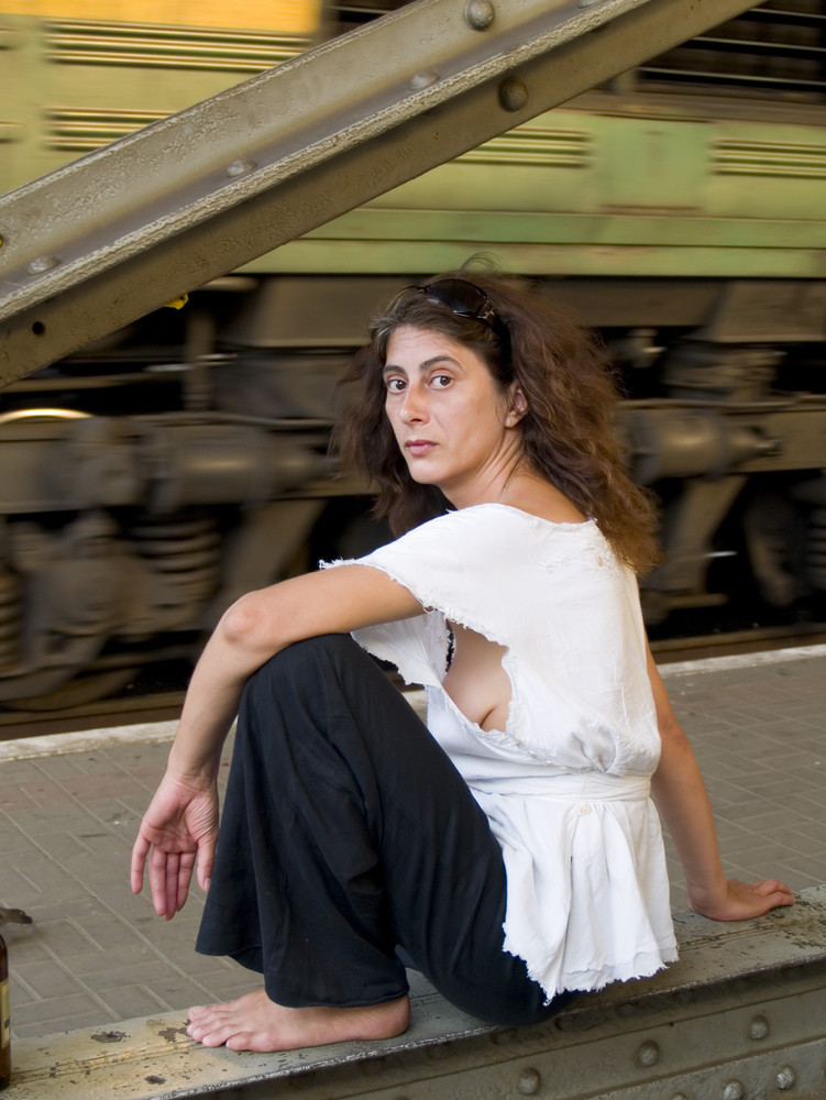 Grunge Lady At The Railway Station