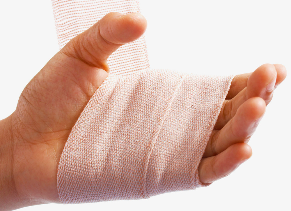 Hand Being Bandaged As Injury