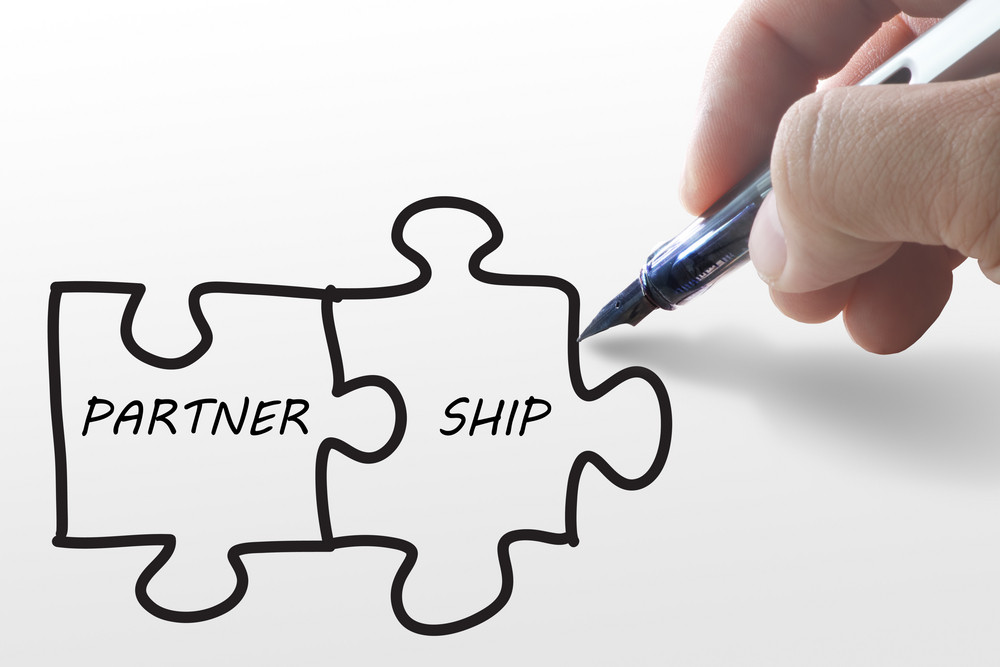 Hand Draw Puzzles And Partner Ship On Paper