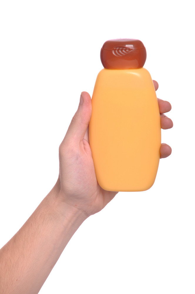 Hand Holding Sun Lotion