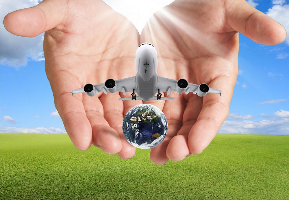 Hand Holds Airbus Plane And Globe