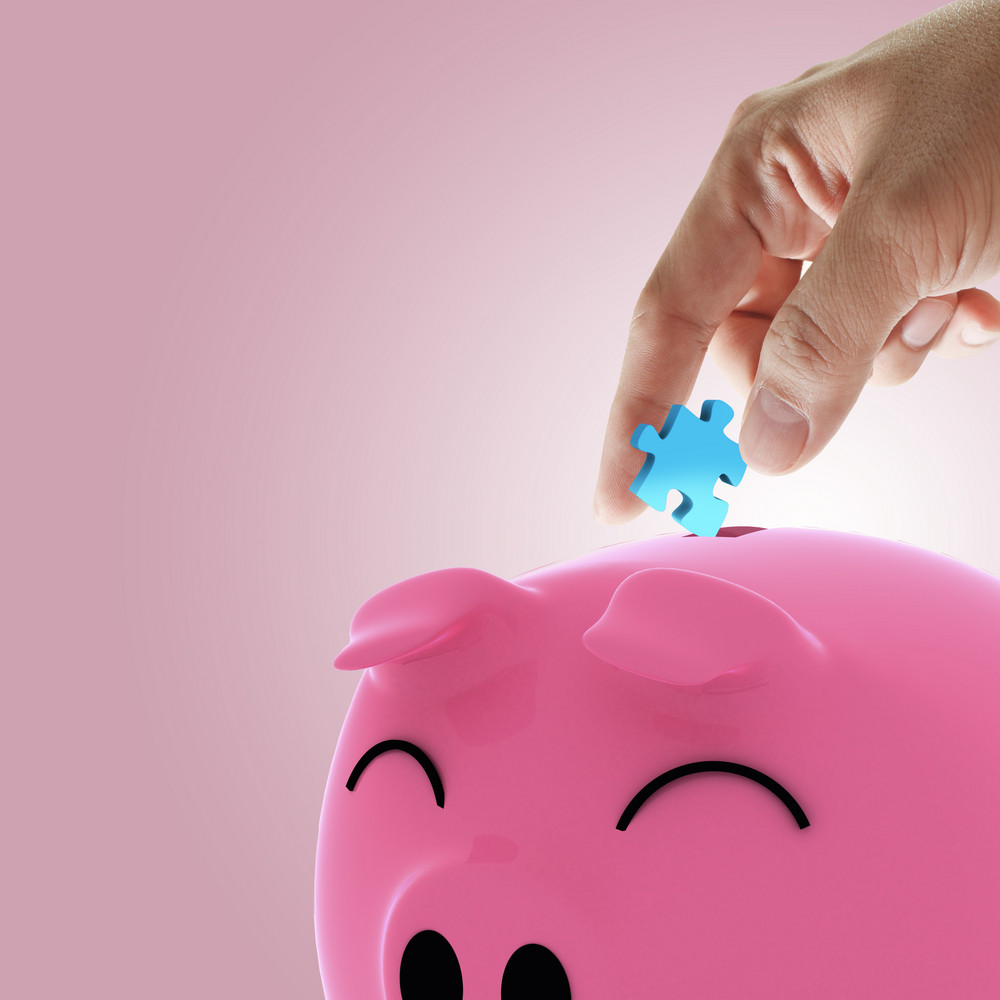 Hand Picking Puzzle To Piggy Bank As Concept
