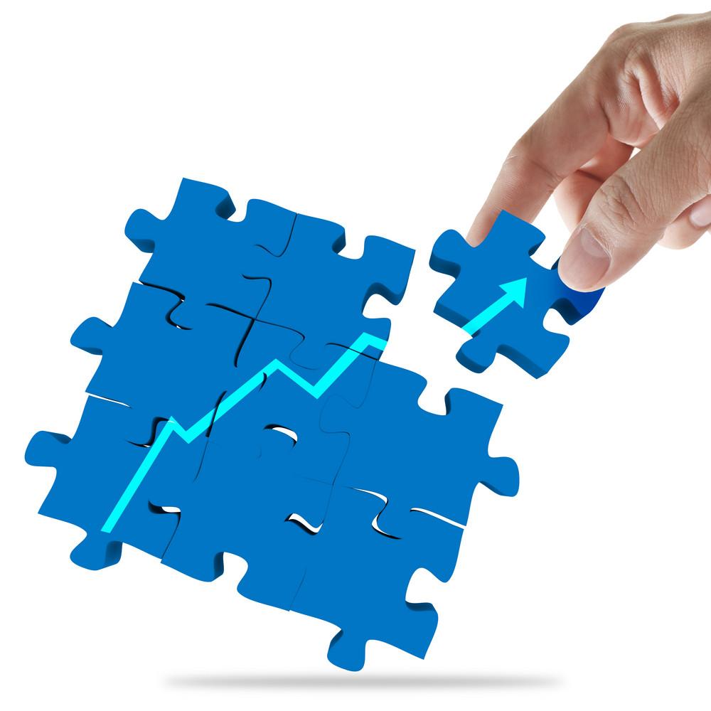Hand Picks Success Puzzle As Concept