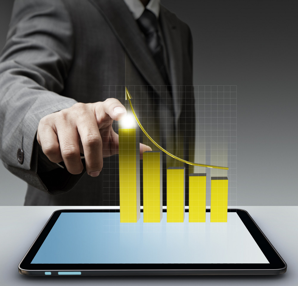 Hand Point To Virtual Gold Graph With Tablet Computer