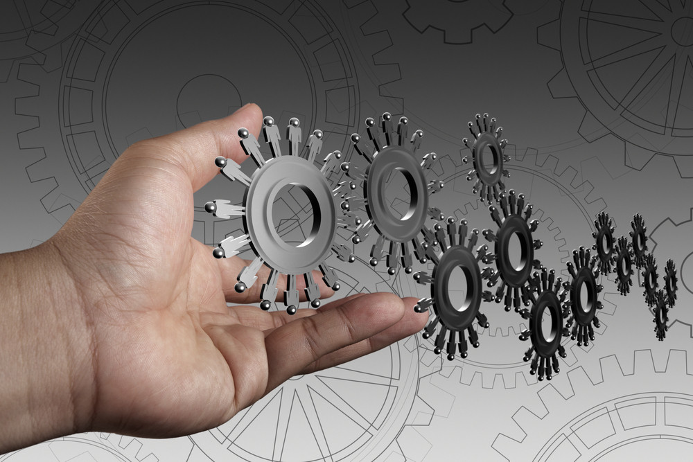 Hand Shows People Cogs As Concept