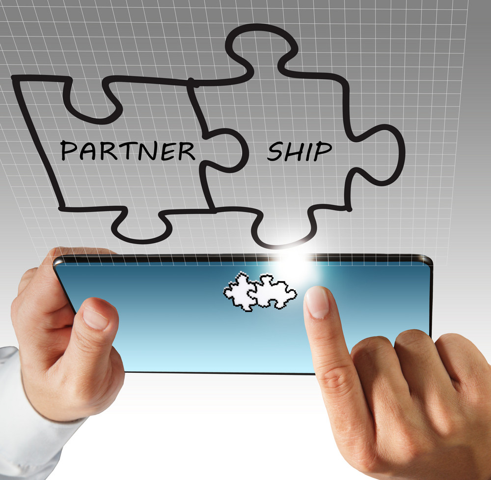 Hand Touch On Tablet Computer And Partnership