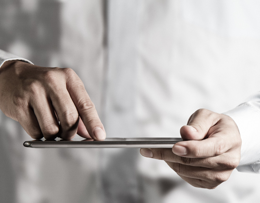 Hand Working On A Digital Tablet