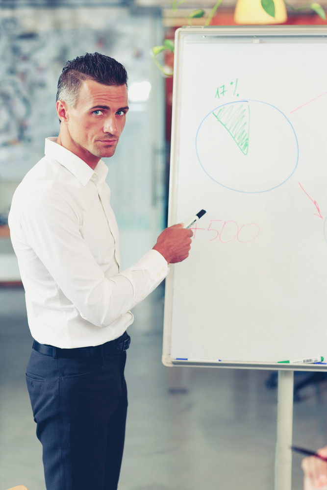 Handsome businessman presenting a new strategy