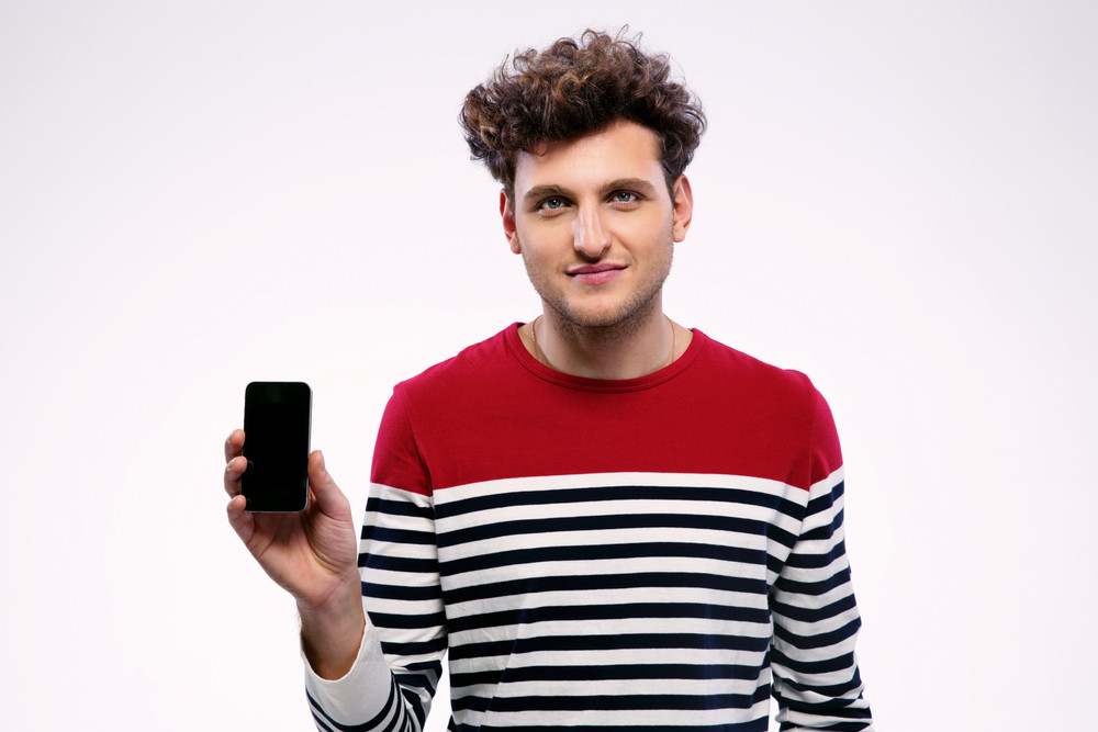 Handsome man showing a blank smartphone display