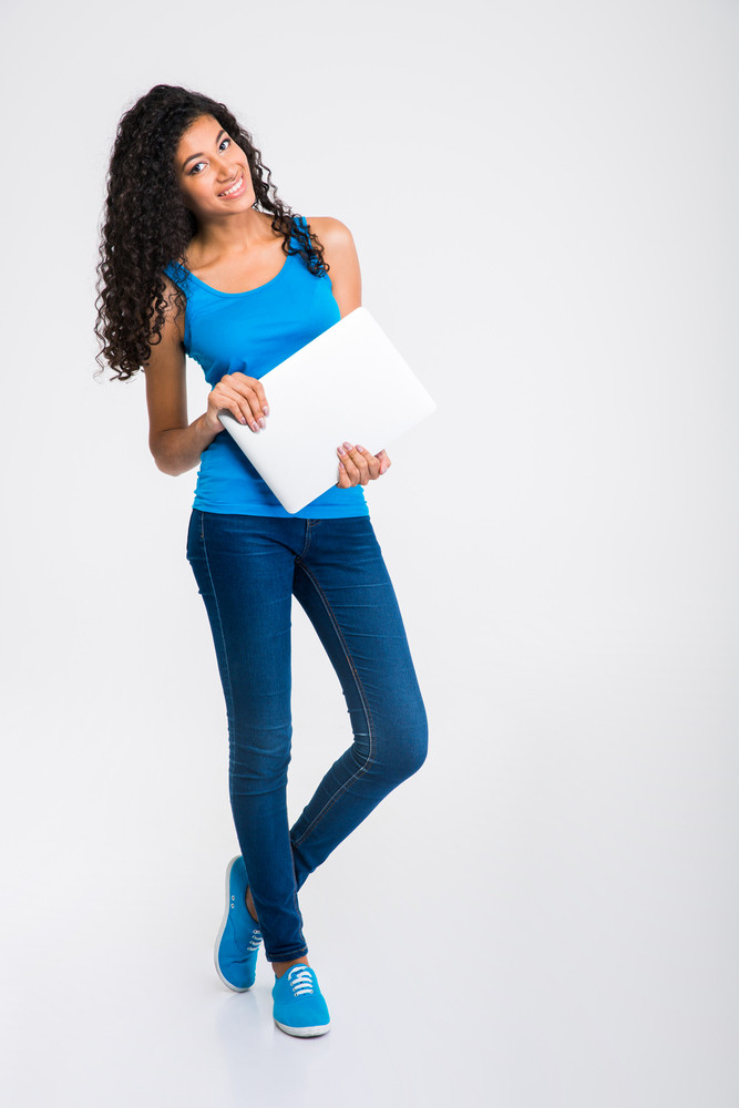 Happy afro american woman holding laptop