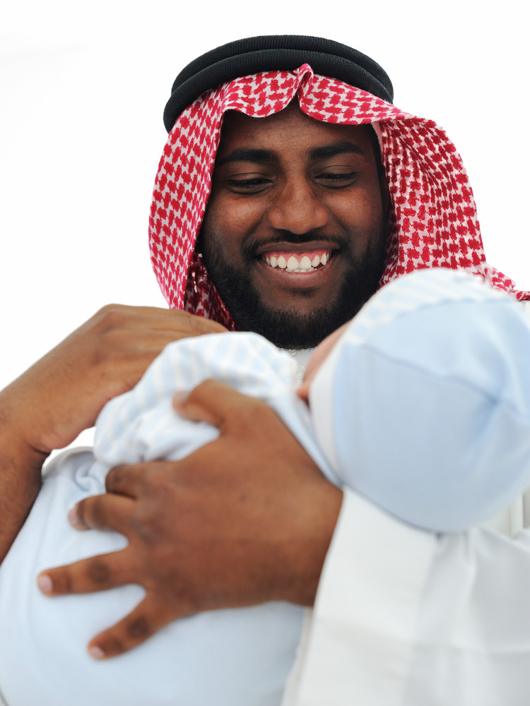 Happy Arabic Father Holding Baby