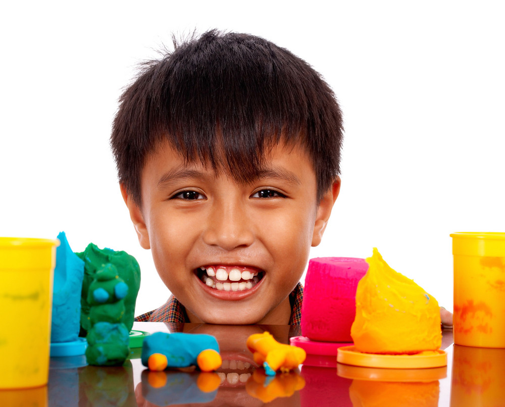 Happy Boy Playing With Colored Dough