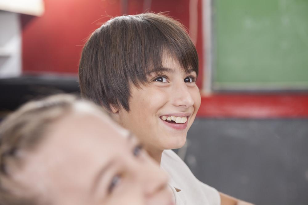 Happy boy smiling in school