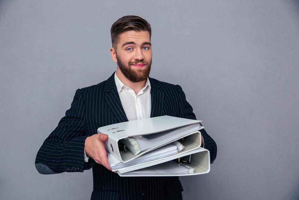 Happy businessman holding folders