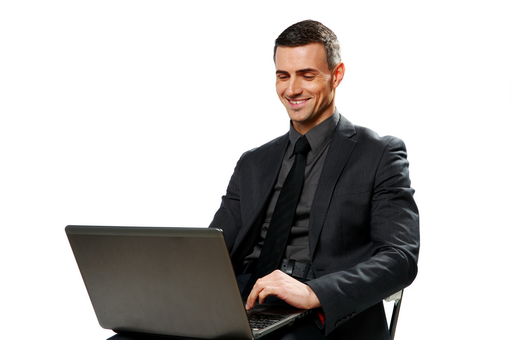 Happy businessman using laptop isolated on a white background