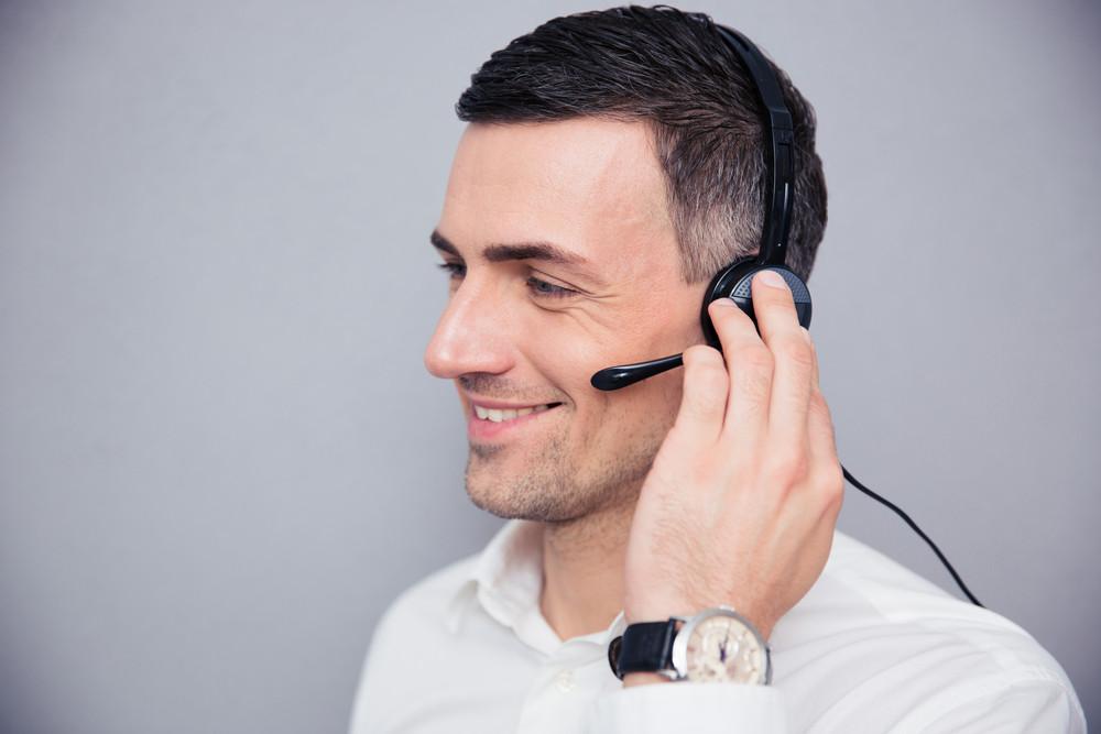 Happy businessman with headphones