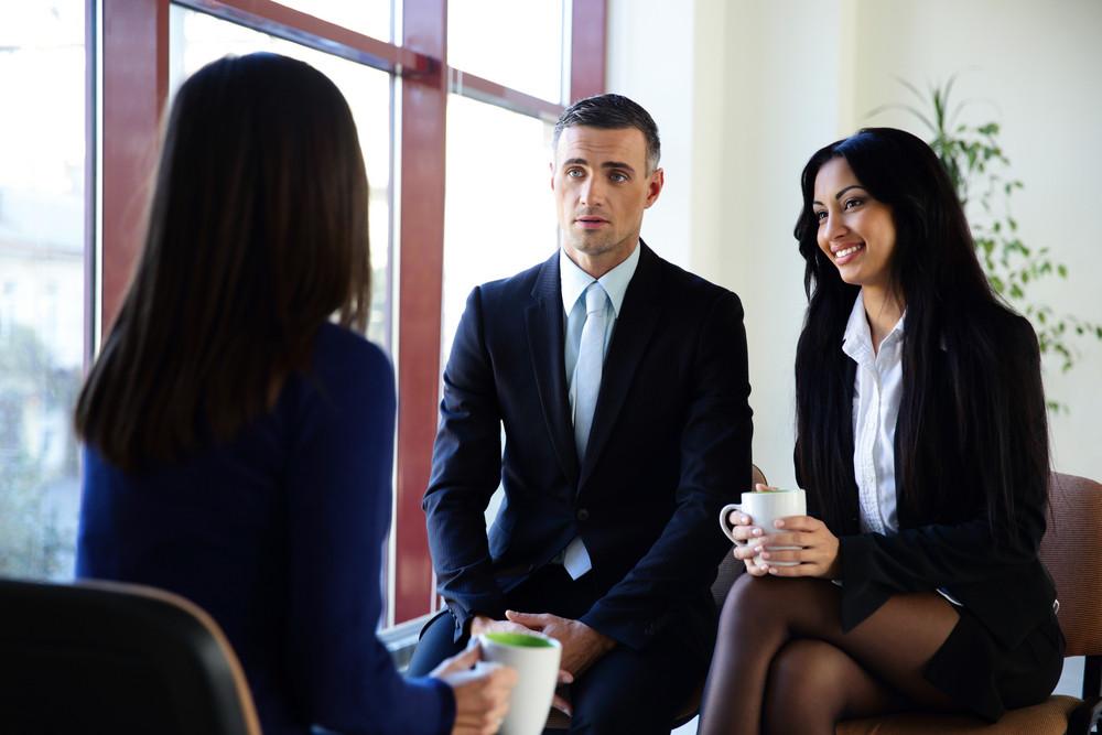 Happy businesspeople having coffee break in office