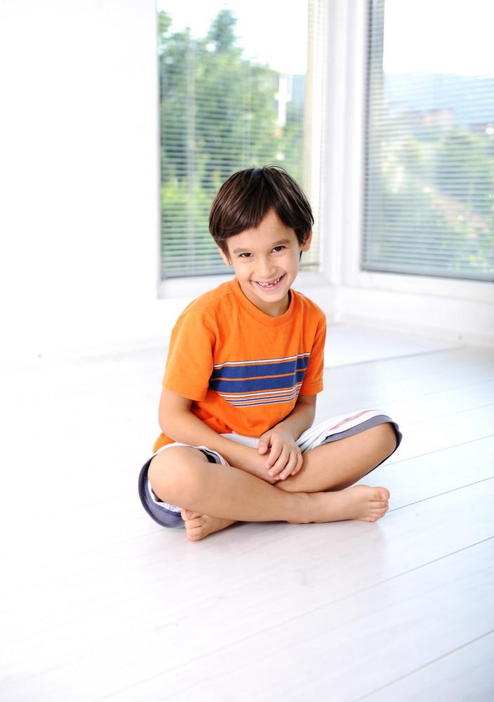 Happy children sitting at home, indoor