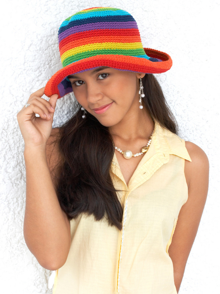 Happy Cute Girl In A Bright Colored Hat