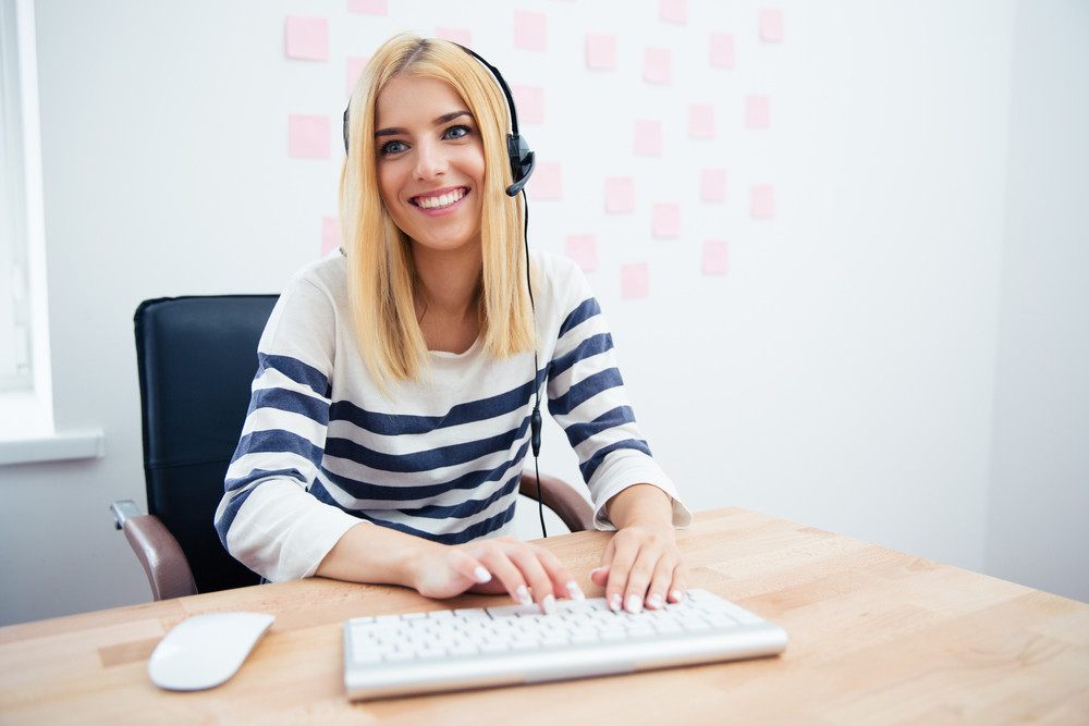 Happy female operator with headset