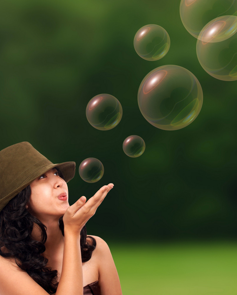 Happy Girl Blowing Some Bubbles