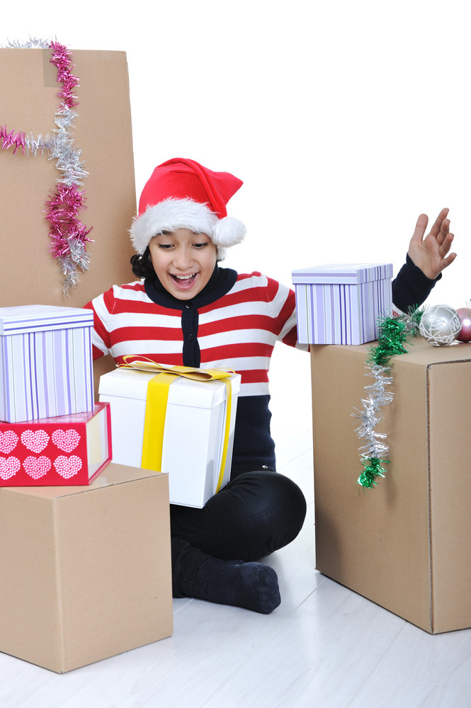 Happy girl with christmas present boxes