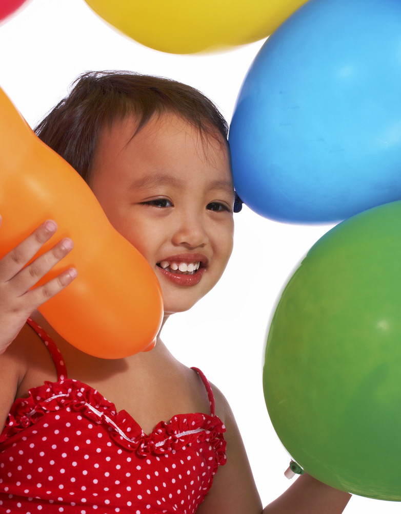Happy Girl With Lots Of Balloons