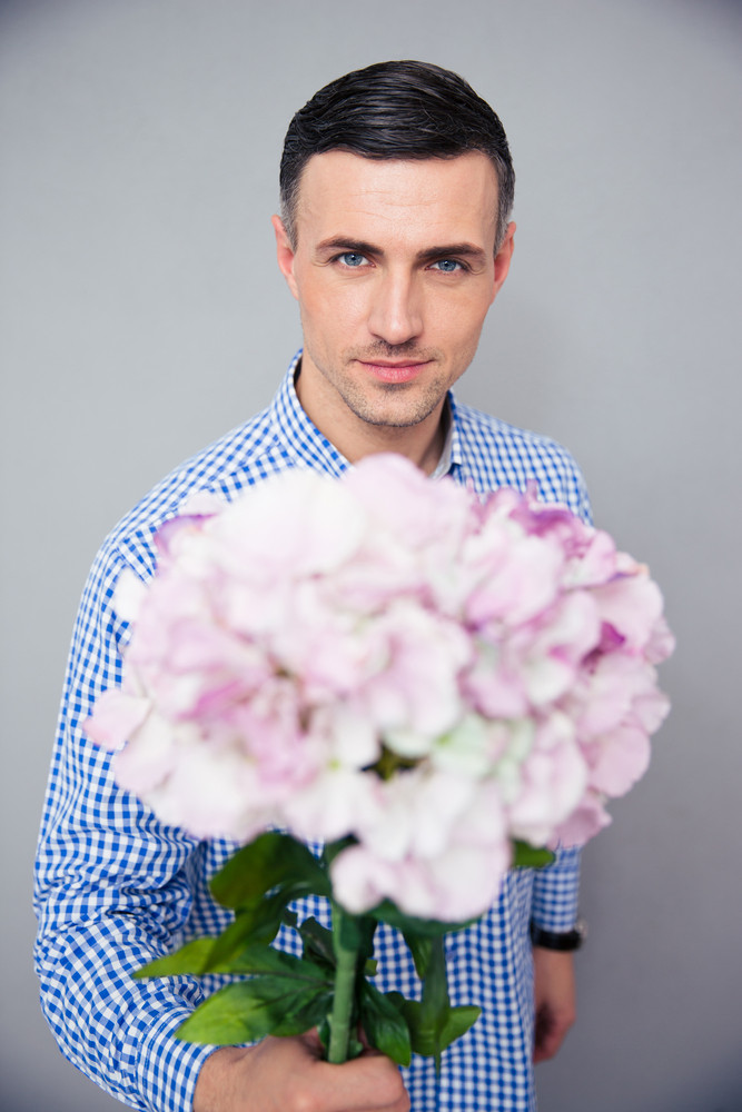 Happy man holding flowers
