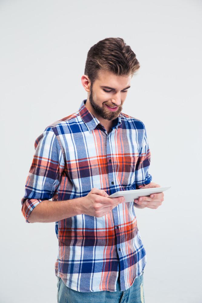 Happy man using tablet computer