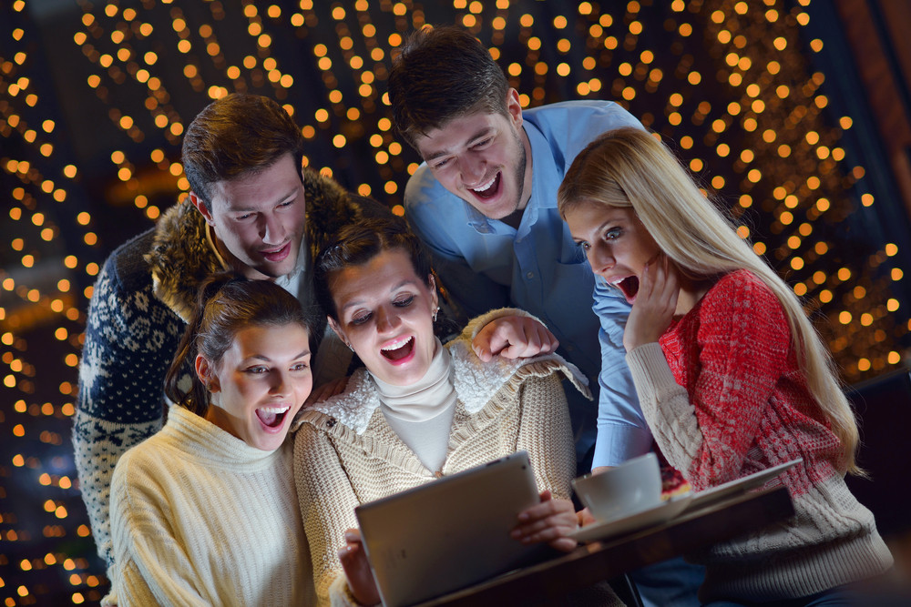 Happy People Looking At A Tablet Computer