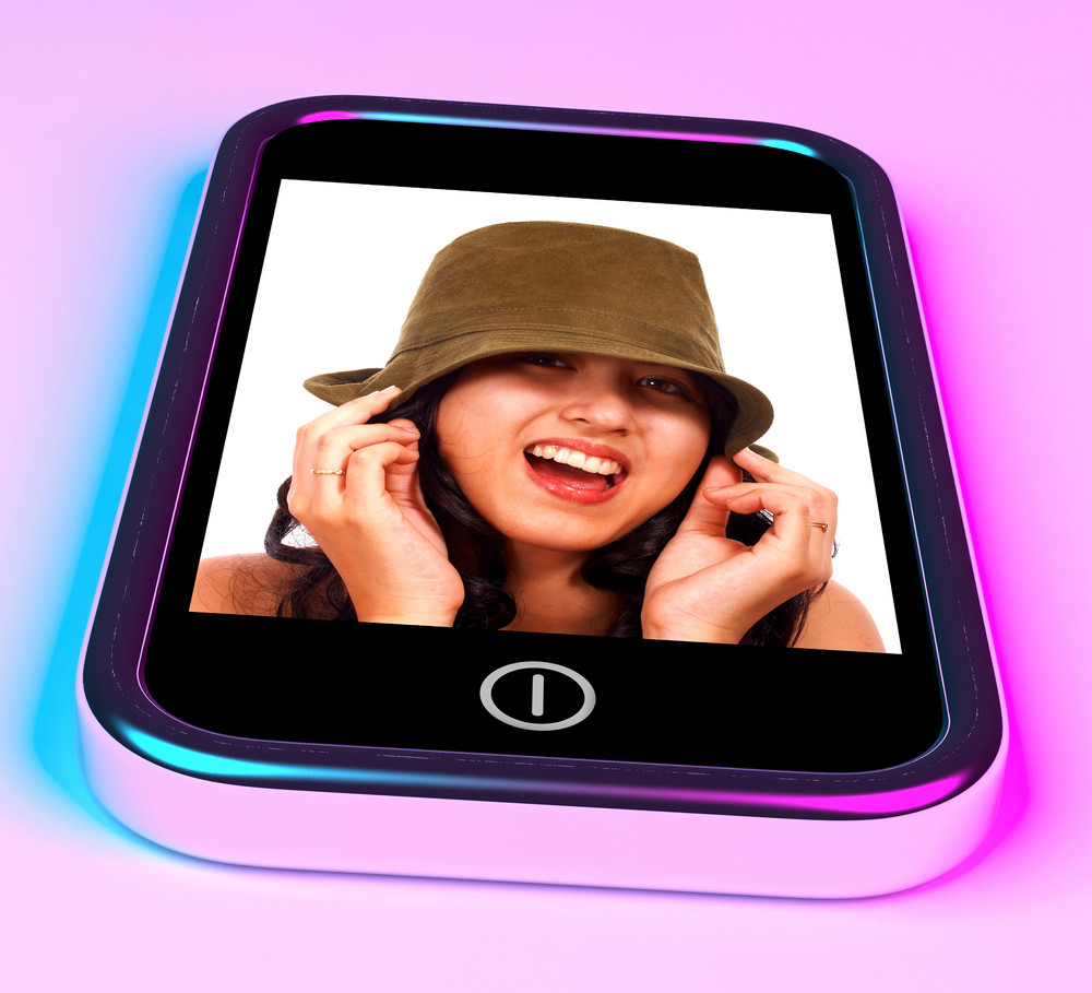 Happy Smiling Teenage Girl Photo On A Mobile Phone