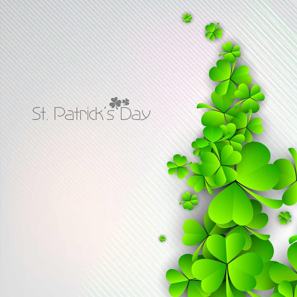 Happy St. Patricks Day Concept With Beautiful Clovers On Grungy Grey Background.