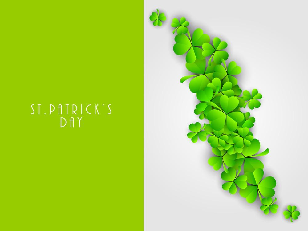 Happy St. Patrick's Day Concept With Green Clover Leaves On Green And Grey Background.