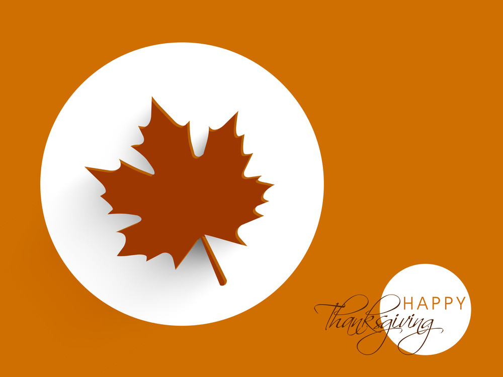 Happy Thanksgiving Day Concept With Beautiful Autumn Leaves On Orange Background.