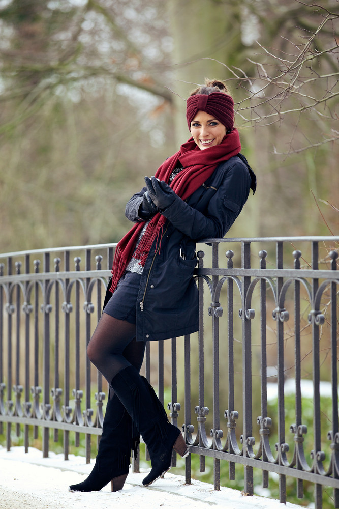 Happy Woman in Stylish Winter Clothing