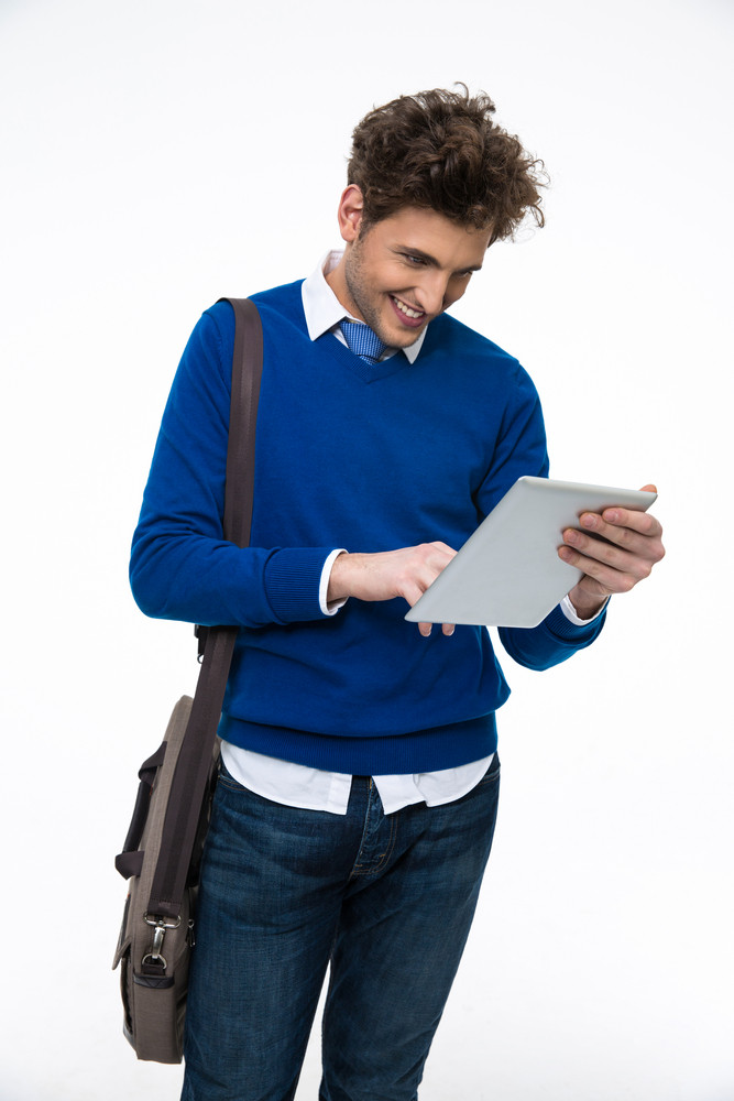 Happy young business man with bag using tablet computer