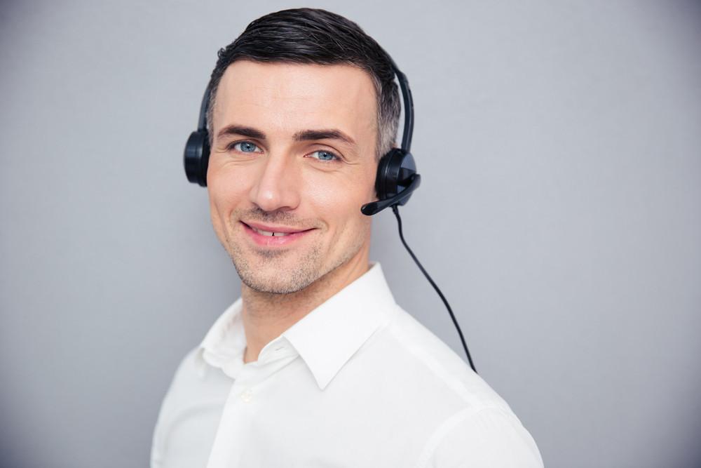 Happy young businessman in headphones