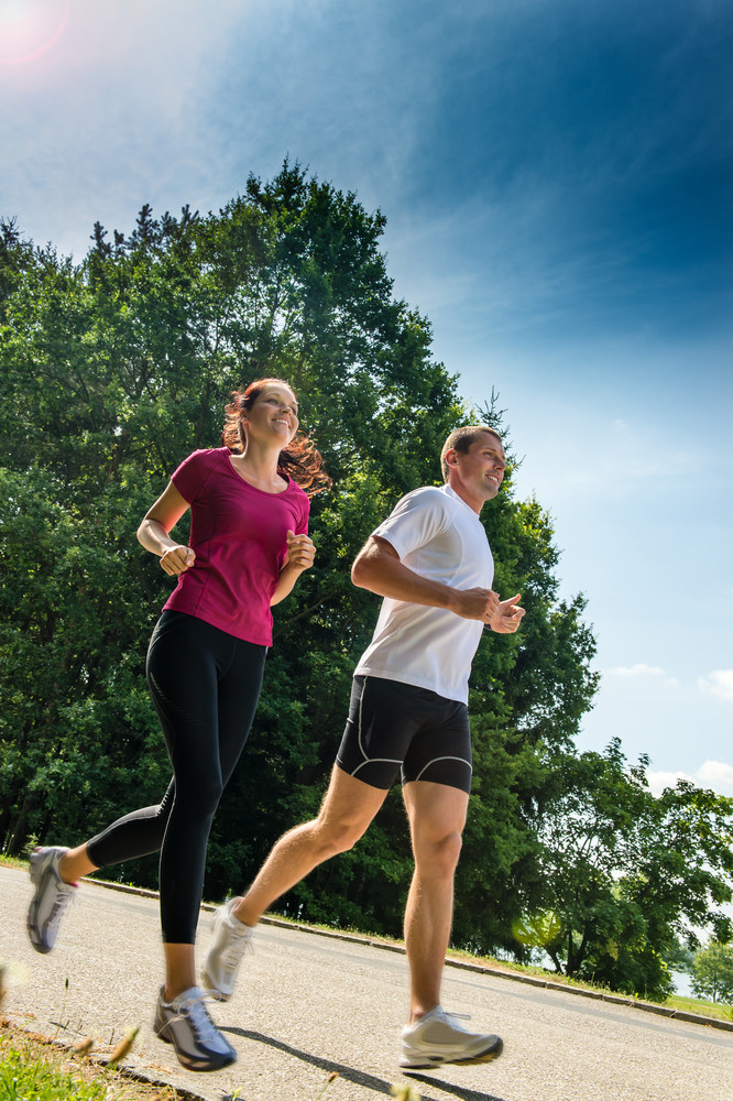 Healthy young couple jogging in a park