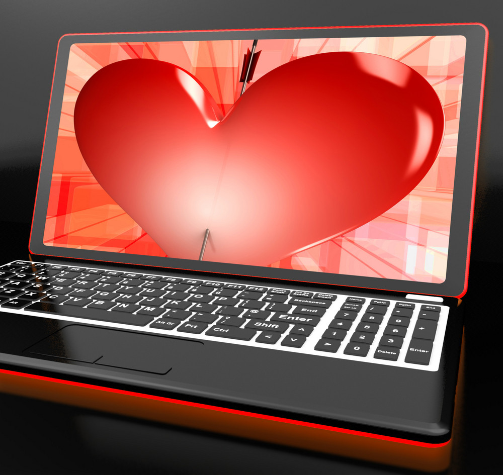 Heart On Laptop Showing Cupid Shot