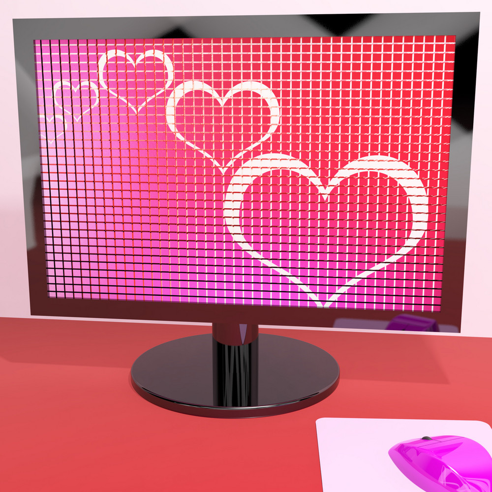 Hearts On Computer Screen Showing Love And Online Dating