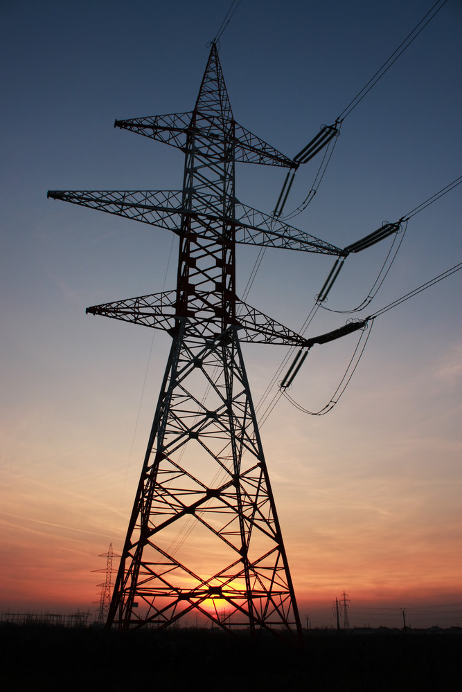 High Voltage Electric Pillar At Sunset