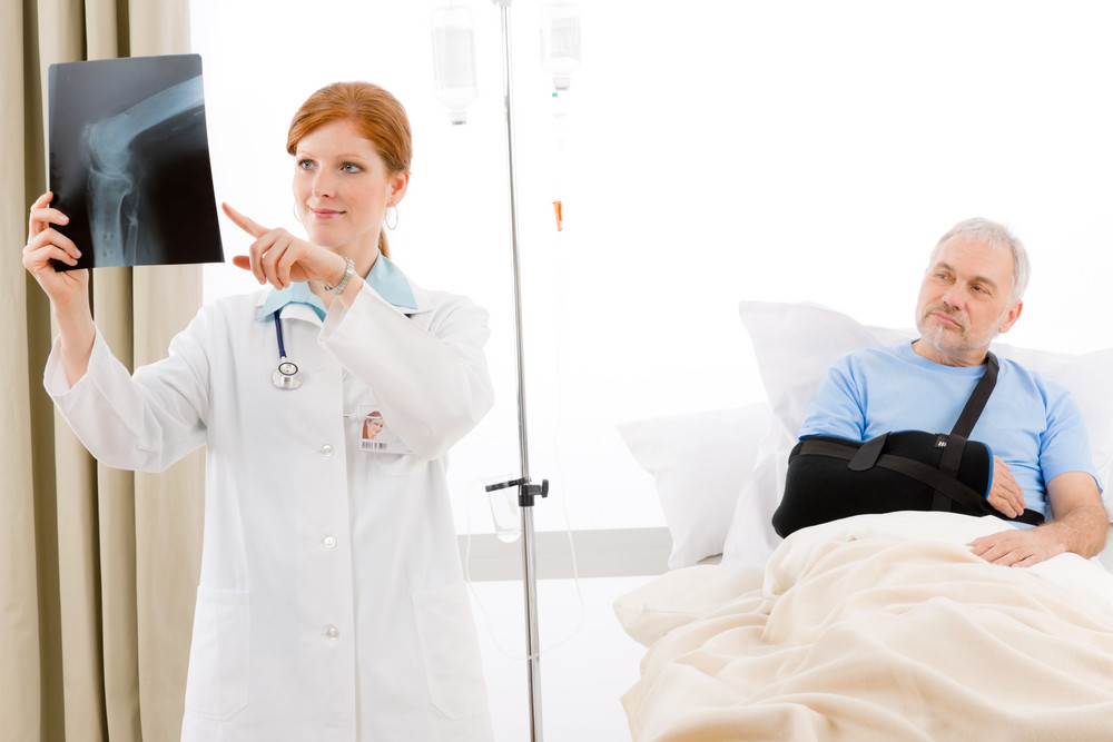 Hospital - female doctor examine senior male patient