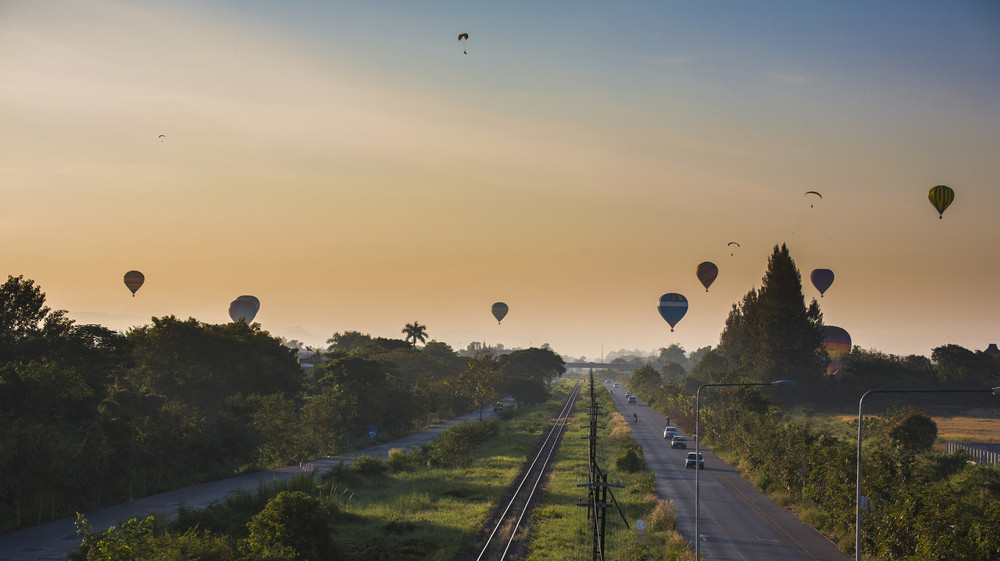 Hot air balloon over train railway, Chiang Mai, Thailand